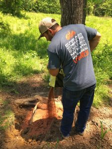 Hunter dumping out Deer Mineral at deer mineral site